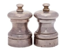 A pair of Elizabeth II silver pepper and salt mills, maker M C Hersey & Sons Ltd, London,