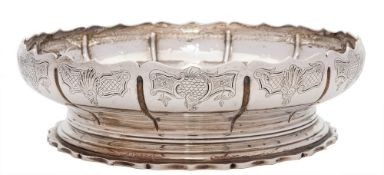 A George V silver shallow bowl, maker Carrington & Co, London, 1913: of circular panelled outline,