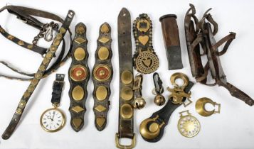 A collection of late 19th/early 20th century horse brasses and tack: and a pair of wooden soled ice