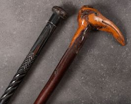 A late 19th/early 20th century Folk Art root wood walking cane of natural form with stylised bird's