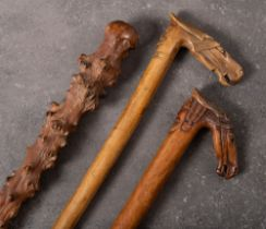 Two late 19th century traditional Greek carved horse head walking sticks: both with horse's head