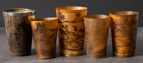 A group of five 19th century horn hunting cups: all with incised decoration,