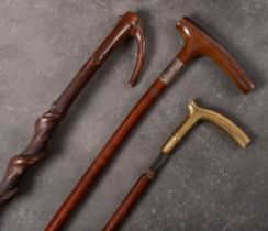 A silver mounted Plantation walking stick: (assay rubbed) together with a bras handled walking