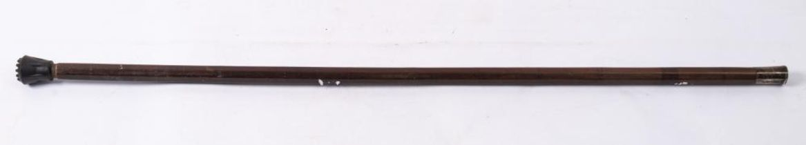 A 17th century white metal mounted octagonal hardwood walking cane: the pommel with engraved