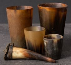 A group of four 19th century horn beakers: all of plain design,