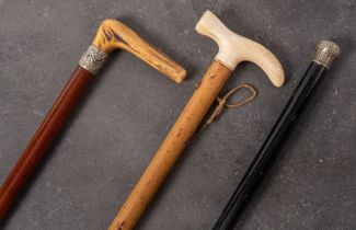 A late 19th/early 20th century ivory handled walking stick on Malacca shaft: 96cm long,