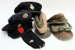 A group of various military berets and cloth caps: (a lot)