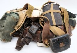 Two leather ammunition belts together with two Sam Browne belts and a collection of various canvas