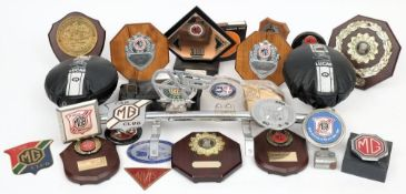 A collection of MG Car Club enamel radiator and bar badges: together with MG Car Club Rally