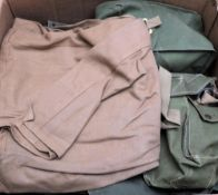 A collection of WWII and later canvas rucksacks,