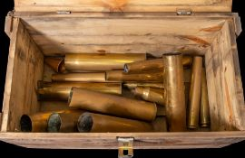 A collection of WWII and later shell cases in an associated wooden armour case: (a lot)