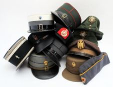 A group of various foreign Kepis and other military caps and berets: (a lot)