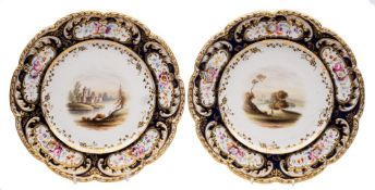 A pair of 19th Century English porcelain dessert plates: the centres painted with lake and