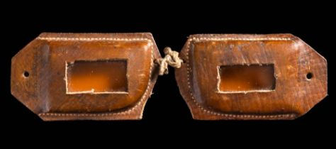 A pair of handmade stitched brown two piece leather snow goggles used by F E C Davies aboard the