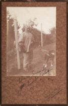 A signed full length photograph of the expedition dog handler Demetri Geroff:,