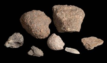 A collection of granite specimens: comprising two large examples and several smaller.