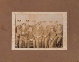 A card mounted sepia photograph of F E Davies and a group of unidentified RN officers: F E Davies