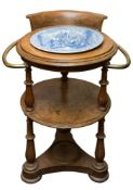 A late 19th/early 20th century circular oak cabin washstand: the smoker's bow style back with two