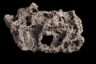 A large specimen of lava from Mt Erebus recovered on the British Antarctic Expedition 1910:, 23cm.