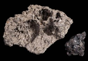 A small specimen of lava from Mt Erebus:, 18cm. long and one other smaller specimen.