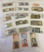 30 vintage foreign bank notes.