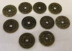 A collection of 10 brass Chinese coins/tokens with square shaped central holes.