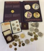 """A collectors Folder """"Diana Portraits Of A Princess"""" containing 2 large gold plated collectors coins."""