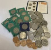A collection of commemorative crowns and American commemorative coins.