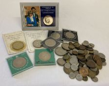 A tub of mixed British commemorative crowns, vintage coins and foreign coins.