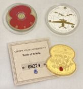 """A 2011 Balliwick of Jersey """"Lest We Forget"""" £5 coin with red poppy to reverse."""
