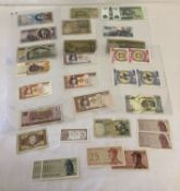 30 vintage foreign bank notes in vary conditions.