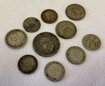 A collection of silver and half silver antique and vintage coins.