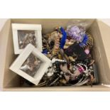 A box of mixed modern costume jewellery, some with original packaging.
