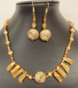 """A boxed 15"""" carnelian and peach freshwater pearl necklace with central 2 sided enamelled bead."""