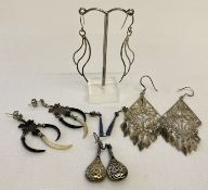 5 pairs of silver and white metal drop style earrings.