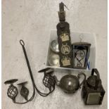 A box of mixed metal ware items. To include horse brasses, silver plate teapot and a lamp.