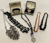 A collection of vintage and modern costume jewellery.