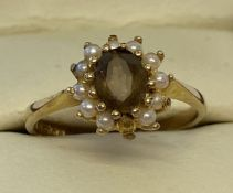 A 9ct gold dress ring set with smoked quartz and seed pearls.