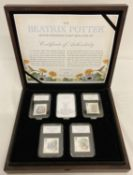 A Limited Edition Beatrix Potter stamp and coin wooden presentation box, limited to 495 pieces.