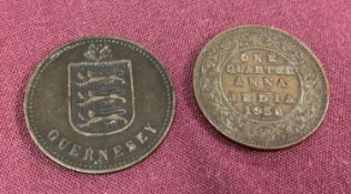A 1914 Guernsey 4 Doubles coin together with a 1936 George V Indian ¼ Anna.
