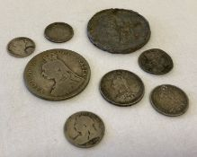 8 silver and white metal Victorian coins in varying conditions.