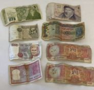 A collection of 8 vintage foreign bank notes from India, Israel, Ireland and Italy.