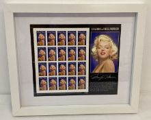 A framed & glazed complete pane of unused American 1995 Legends Of Hollywood Marilyn Monroe stamps.