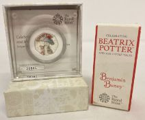 A boxed Royal Mint Limited Edition Benjamin Bunny 2017 silver proof 50p coin with coloured detail.