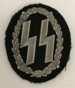 A German WWII style Waffen SS woman's breast pocket badge.