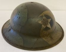A WWI style US 2nd Infantry Doughboys helmet (no liner) with hand painted jigsaw pattern camouflage.