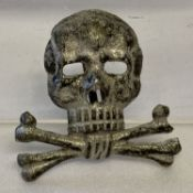 A German WWI/2 style Brunswick Regiment skull badge.