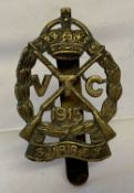 A British WWI Surrey Volunteer Corps cap badge with slider fixing to reverse.
