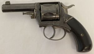 An antique .442 obsolete calibre British Bulldog revolver with ebonized wooden grip.