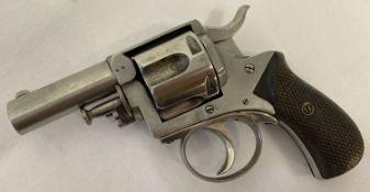 An antique .44 British Bulldog revolver with wooden grip.